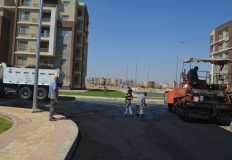 """الإسكان"""": رصف الطرق لعمارات """"دار مصر"""" غرب المال والأعمال والحي الـ32"""